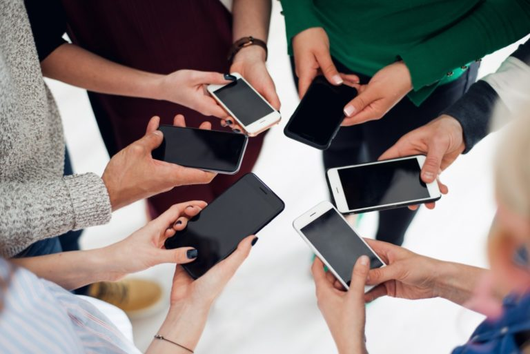 Group using their mobile phones
