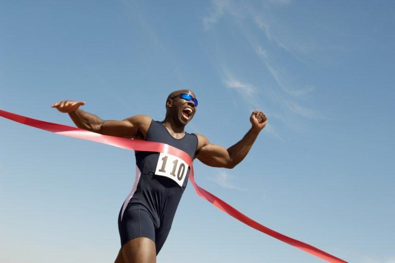 runner crossing the finish line