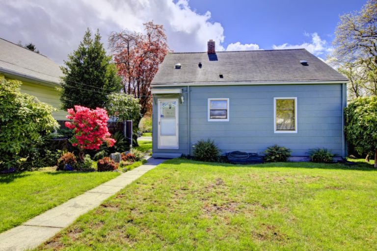 Small house with empty yard