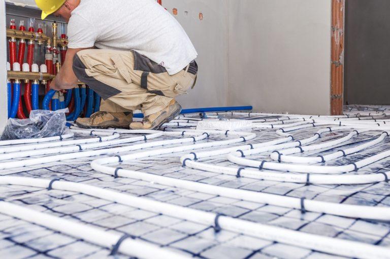 man installing floor heating