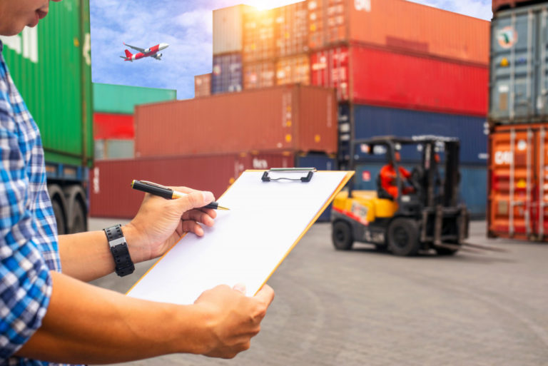 man checking freight containers