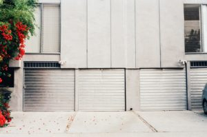 3 garage doors urban city