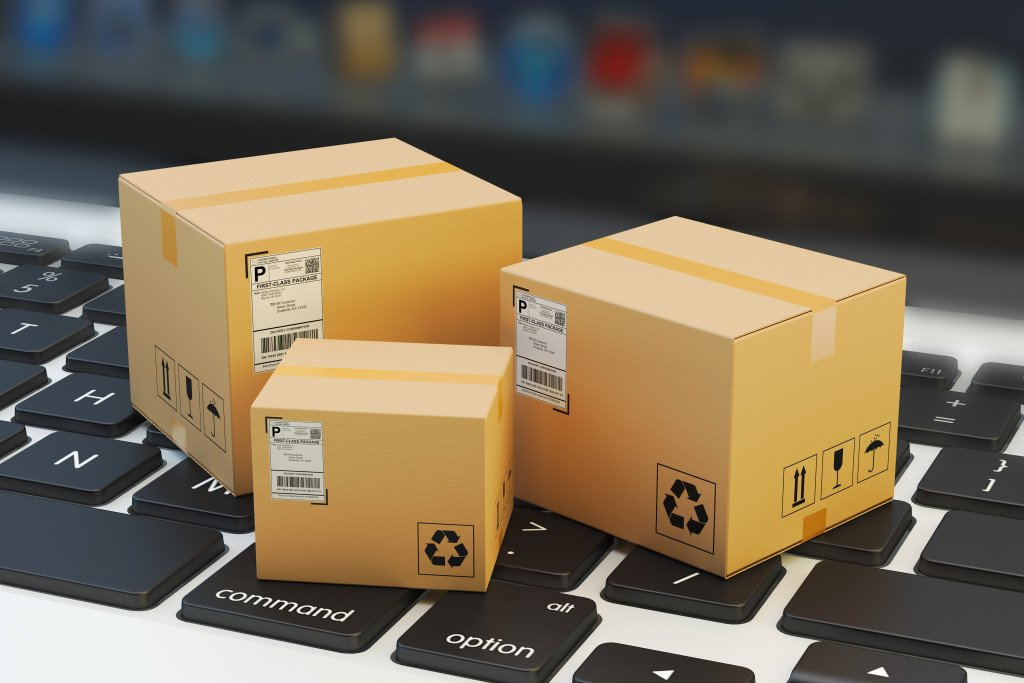 small shipping boxes on a laptop