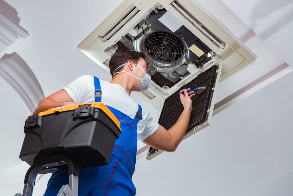 man cleaning HVAC system