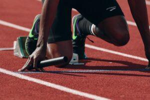 Man getting ready to run track
